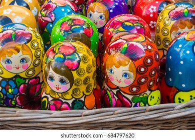 MOSCOW, RUSSIA - JULY 26, 2017: Colorful bright russian nesting dolls Matrioshka in the basket at the street market at Old Arbat street, iconic popular souvenir from Russia.