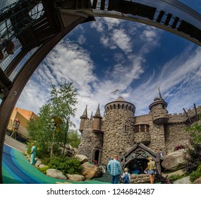 MOSCOW, RUSSIA - JULY 26, 2018: Unidentified people visit fairytale castle with extreme rope ladder  way and safety net in children's amusement park Lukomorye in Moscow, Russia on July 26, 2018.