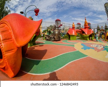 MOSCOW, RUSSIA - JULY 26, 2018: Unidentified people look at  playground equipment in children's amusement park Lukomorye in Moscow, Russia on July 26, 2018.