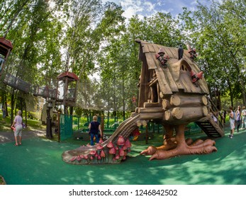 MOSCOW, RUSSIA - JULY 26, 2018: Unidentified people look at  fairytale hut on chicken legs in children's amusement park Lukomorye in Moscow, Russia on July 26, 2018.