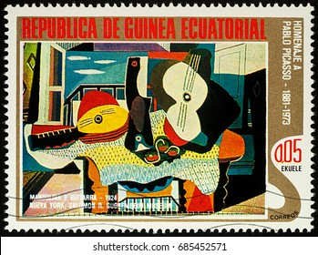 """Moscow, Russia - July 27, 2017: A stamp printed in Equatorial Guinea, shows painting Mandolin and guitar by Pablo Picasso, series """"Picasso: Abstract paintings"""", circa 1975"""