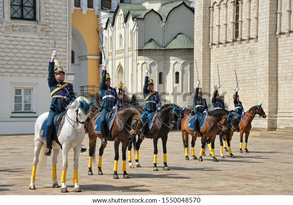 MOSCOW, RUSSIA - July 27, 2019 Сavalrymen of Presidential Regiment demonstrate possession of a saber at the end the Ceremonial Changing of Foot & Cavalry Guards on Cathedral Square of Moscow Kremlin