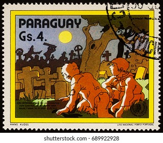 """Moscow, Russia - July 30, 2017: A stamp printed in Paraguay shows Tom Sawyer and Huck Finn at the cemetery, Adventures of Tom Sawyer by Mark Twain, series """"International Year of Youth"""", circa 1985"""