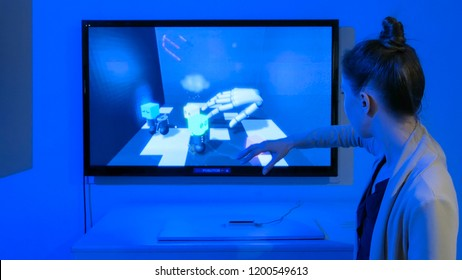 MOSCOW, RUSSIA - July 30, 2018: Robostation - future exhibition. Woman playing motion capture video game