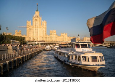 MOSCOW, RUSSIA - July 31,2021: View on the Moskvoretskaya embankment and high-rise building on the Kotelnicheskaya embankment and Moskva-river. Summer cityscape from travel boat