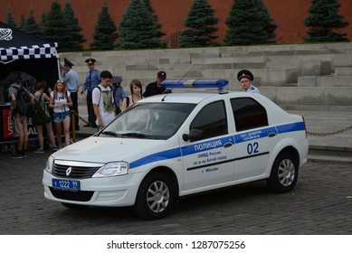 MOSCOW, RUSSIA - JULY 5, 2013: Russian police Renault (Dacia) Logan nearby Kremlin Wall at the Moscow Red Square