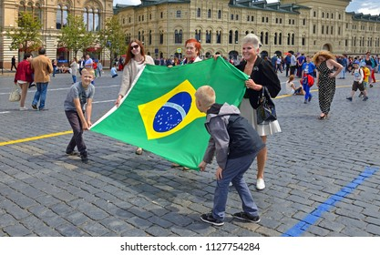 MOSCOW, RUSSIA - JULY 5, 2018: 2018 FIFA World Cup. Fans with Brazilian flag on Red Square