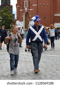 MOSCOW, RUSSIA - JULY 5, 2018: 2018 FIFA World Cup. Fan with his son on Red Square