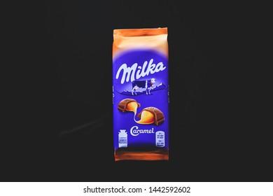 MOSCOW, RUSSIA - JULY 5, 2019: Milka alpine milk chocolate bar with caramel, marketed by Mondelez International. Milka is the first milk chocolate bar in the world.