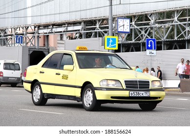 MOSCOW, RUSSIA - JULY 7, 2012: Yellow Mercedes-Benz W202 C-class taxi at the city street.
