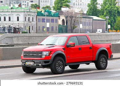 MOSCOW, RUSSIA - JULY 7, 2012: Red pickup truck Ford F-150 Raptor at the city street.