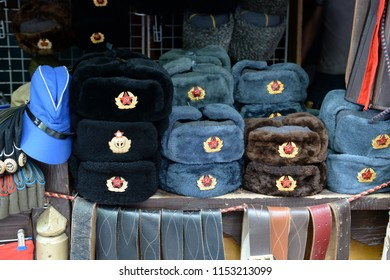 MOSCOW, RUSSIA JULY 7, 2018: Military caps with Soviet cockades laid out on a souvenir counter in the city of Moscow