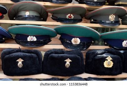 MOSCOW, RUSSIA JULY 7, 2018: Military caps with Soviet cockades laid out on a souvenir counter in the city of Moscow.