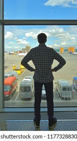 MOSCOW, RUSSIA - JULY 7, 2018: Sheremetyevo International Airport, Terminal D. Silhouette of young man in airport lounge waiting for flight aircraft