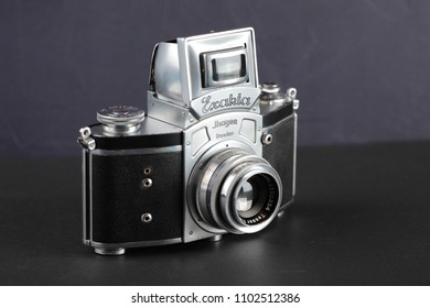 MOSCOW, RUSSIA, JUNE 01, 2018. The old German 35 mm SLR camera Kine Exakta with Carl Zeiss lens Tessar 2,8/50, released 1938, on a dark background.