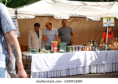 Moscow, Russia, June 01, 2019: men Indians sell Indian goods in the trading pavilion. Indian Bazaar at the Embassy of India