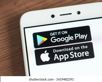 Moscow, Russia - June 03, 2019: Google Play and App Store icons on smartphone screen. App store and Google play are competitors in market of applications for smartphones. Selective focus.