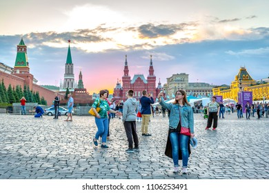 Moscow, Russia - June 04 2018: Tourists and locals enjoying a beautiful sunset at the Red Square, the main square of Moscow.