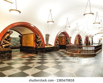 MOSCOW, RUSSIA - June 04, 2018. Hall of Ploshchad Revolyutsii (Revolution Square) Moscow Metro station. Interior of underground transport system. Statues of people doing different things.