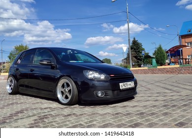 Moscow, Russia - June 04, 2019:  Tuned and understated Volkswagen golf 6 black. Air suspension and custom polished alloy wheels parked on the street