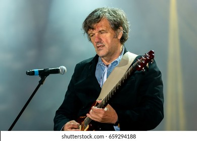 """MOSCOW, Russia – June 04: Emir Kusturica plays guitar with the musicians on the football musical festival """"Art-football 2017""""at the Lokomotiv stadium. 04 June 2017 in Moscow, Russia."""