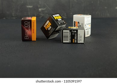 MOSCOW, RUSSIA, JUNE 05, 2018. Film packings lford & Kodak for old 35 mm SLR camers on black cement background.