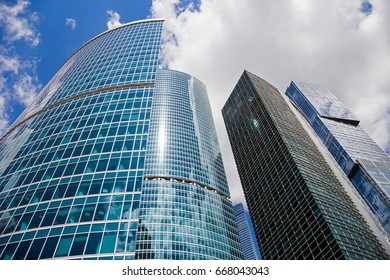 MOSCOW, RUSSIA - JUNE 07, 2017: Skyscraper against a blue sky with clouds