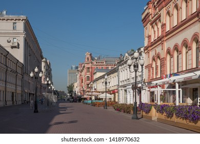 Moscow/ Russia -, June 07, 2019: The early summer morning. Locals and tourists walk along Arbat Street. Arbat is a pedestrian zone and famous tourist attraction in the historical center of Moscow.
