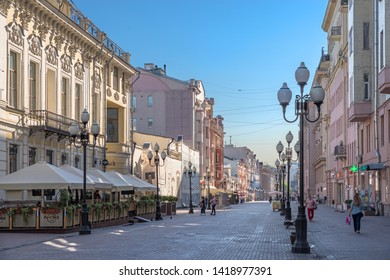 Moscow/ Russia - June 07, 2019: The early summer morning. Locals and tourists walk along Arbat Street. Arbat is a pedestrian zone and famous tourist attraction in the historical center of Moscow.
