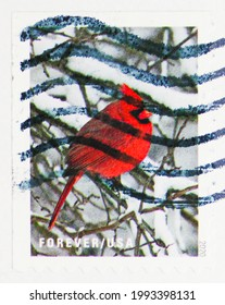 MOSCOW, RUSSIA - JUNE 09, 2021: Postage stamp printed in USA shows Cardinal (Cardinalis cardinalis), Winter Scenes (2020) serie, circa 2020