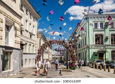 Moscow, Russia - June 1, 2016: Kamergersky lane decorated birds and arch with flowers - Spring Festival in the historic center of Moscow.