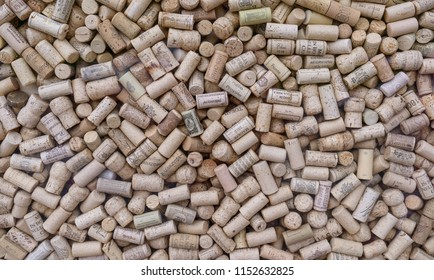 MOSCOW, RUSSIA - JUNE 10, 2017: A pile of wine corks with a variety of logos and names.
