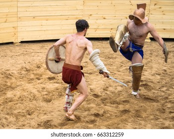 """Moscow, Russia - JUNE 10, 2017: Gladiators fight in the arena. International festival of historical reconstruction """"Times and epochs"""" in the Kolomenskoye Park"""
