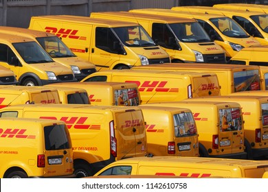 Moscow, Russia - June 10, 2018: Many yellow DHL cars in the parking lot