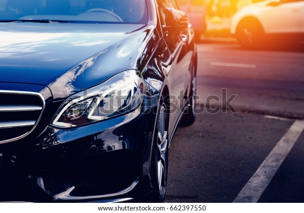 Moscow, Russia- June 12, 2017:  Black Mercedes Benz on the street toned with glare of the sun