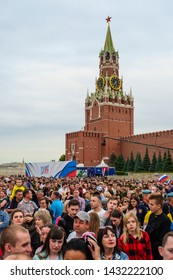 Moscow, Russia - June, 12, 2019: the image of a crowd of people at an open-air concert dedicated to the Day of Russia on June 12 against the backdrop of the Kremlin's Spasskaya Tower in Moscow