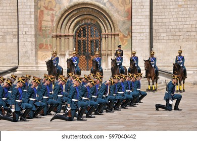 MOSCOW, RUSSIA - June 13, 2009  Honor Guards of Kremlin Regiment kneel down and bow heads during fascinating ceremonial of changing of guards in Cathedral Square of Moscow Kremlin.