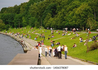 MOSCOW, RUSSIA - June 14, 2008. People are resting and sun tanning in Sparrow Hills park. Moscow-river embankment with relaxing local people and tourists.