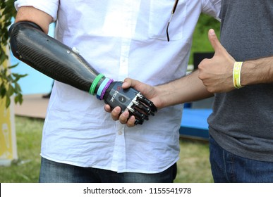 Moscow, Russia, June 14, 2015, Handshake of a bionic prosthesis and human hand