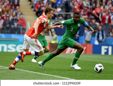Moscow, Russia - June 14, 2018. Saudi Arabian defender Osama Hawsawi against Russian midfielder Aleksandr Golovin in the opening match of FIFA World Cup 2018 Russia vs Saudi Arabia.