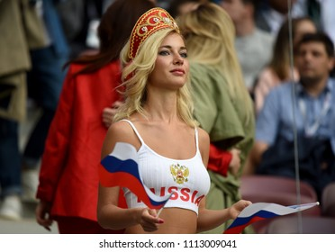 Moscow, Russia - June 14, 2018. Beautiful Russian lady waving Russian flags during the opening match of FIFA World Cup 2018 Russia vs Saudi Arabia.