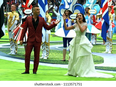 Moscow, Russia - June 14, 2018. British singer Robbie Williams and  Russian opera singer Aida Garifullina performing at the opening ceremony of FIFA World Cup 2018 in Russia.