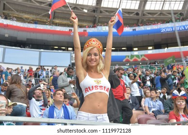 "MOSCOW, RUSSIA - June 14, 2018: Russia fans celebrating during the World Cup Group A game between Russia and Saudi Arabia at Luzhniki. The dazzling blonde beauty dubbed the ""sexiest fan"" of the World"
