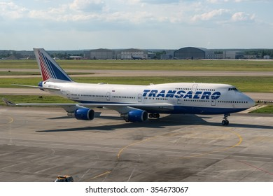 Moscow, Russia - June 15, 2013: The Boeing 747-400 Transaero EI-XLJ taxiing to terminal at Moscow Sheremetyevo Internatioanl airport.