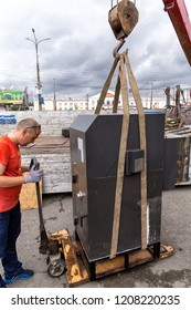 Moscow, Russia - June 15, 2017: Loading the ATM on the truck. Transportation ATM to manual hydraulic pallet trucks