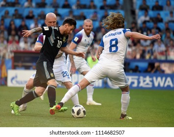 Moscow, Russia - June 16, 2018. Argentina national football team captain Lionel Messi and Icelandic players Emil Hallfredsson and Birkir Bjarnason during FIFA World Cup 2018 match Argentina vs Iceland