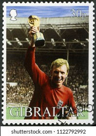 MOSCOW, RUSSIA - JUNE 16, 2018: A stamp printed in Gibraltar shows Robert Frederick Chelsea Bobby Moore (1941-1993), 1966 World Cup Soccer Champions, commemorates England Captain Bobby Moore, 2002