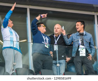 Moscow, Russia - June 16, 2018. Retired Argentinian football player Diego Maradona at FIFA World Cup 2018 match Argentina vs Iceland, with TV journalists and security.