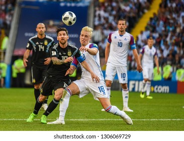 Moscow, Russia - June 16, 2018. Argentina national football team captain Lionel Messi and Iceland defender Hordur Magnusson during FIFA World Cup 2018 match Argentina vs Iceland.