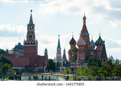 Moscow, Russia - June 16, 2019: View of the Kremlin, the Spasskaya Tower and St. Basil's Cathedral from Zaryadye Park. The park is a new tourist attraction in Moscow